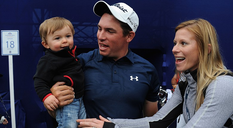 Scott Stallings meets his wife, Jennifer, and his son, Finn, on the 18th hole after winning the Farmers Insurance Open on Torrey Pines South.