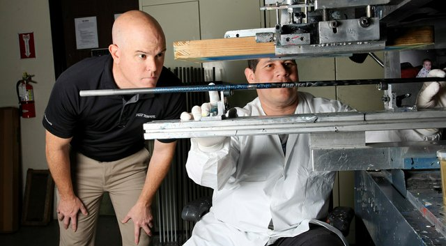 Don Brown (left, with silk screener Arturo Banuelos), with an undergraduate degree in metallurgical engineering and masters degree in materials engineering, was working on a doctorate when he decided to step into the working world with True Temper.
