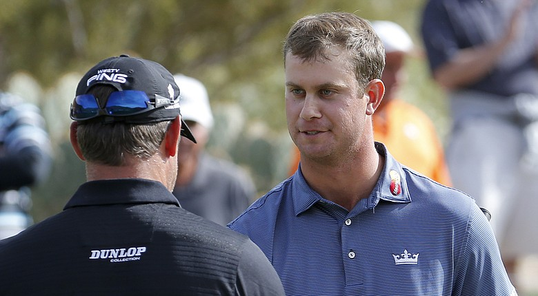 Harris English, right, after his win over Lee Westwood, left, in the first round of the 2014 WGC-Accenture Match Play at Dove Mountain in Marana, Ariz.
