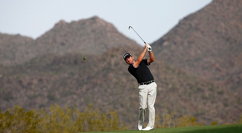 Graeme McDowell plays a shot on the 19th hole during the third round of the WGC-Accenture Match Play Championship.