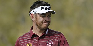 Back pain prompts Oosthuizen to reassess schedule