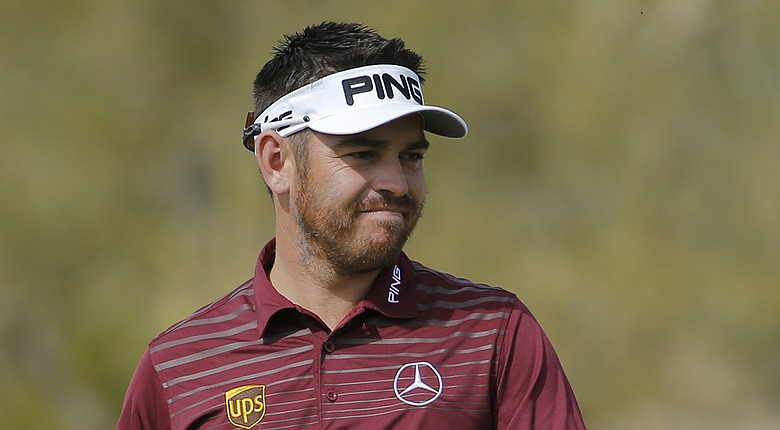 Louis Oosthuizen has been testing his ailing back at Trump National Doral to see if he can play in this week's 2014 WGC-Cadillac Championship; he felt pain at the WGC-Accenture Match Play (shown here).