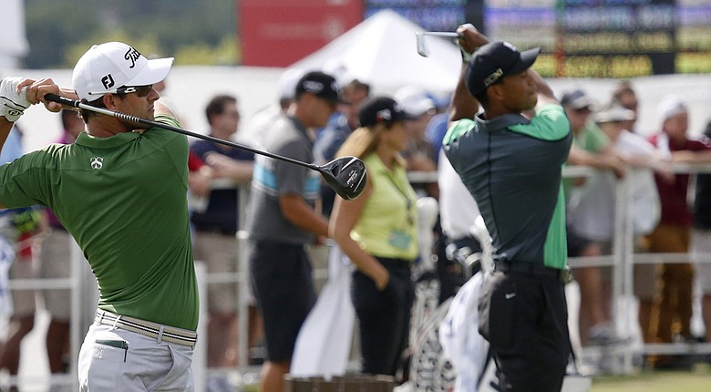 Tiger Woods, right, will share a tee time with Adam Scott, left, and Henrik Stenson, not shown, if Woods' back is healthy enough for the 2014 WGC-Cadillac Championship (shown during practice for last year's BMW Championship).