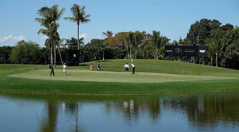 Players test the redesigned 15th hole prior to the start of the WGC-Cadillac Championship at Trump National Doral.