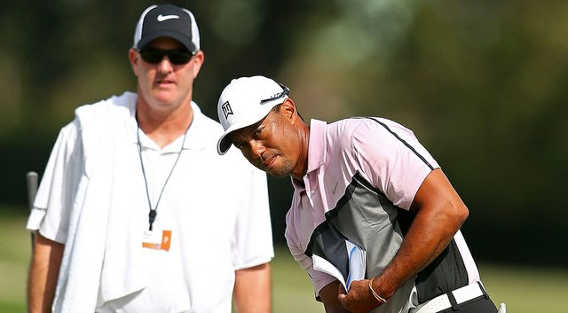 Tiger Woods said he was limited to shots of 60 yards and less during his preparation Wednesday for the 2014 WGC-Cadillac Championship at Trump National Doral.