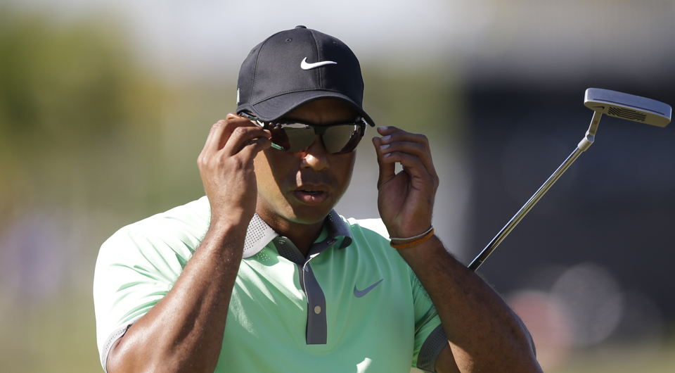 Tiger Woods, having rebounded from two tough rounds for a 66, starts Sunday at Trump National Doral three back of leader Patrick Reed in the WGC-Cadillac Championship. Follow the highlights right here!
