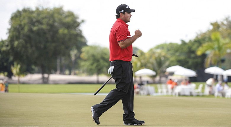 Patrick Reed celebrates after making a birdie putt on the fourth hole during the final round of the WGC-Cadillac Championship.
