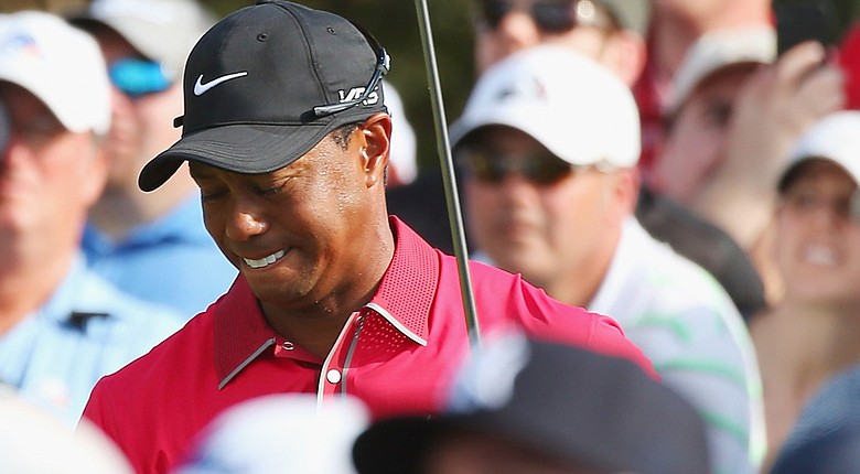 Tiger Woods withdrew from the Arnold Palmer Invitational on Tuesday, citing lingering back spasms.