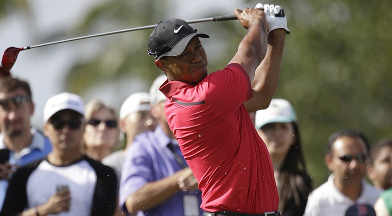 Tiger Woods withdrew, citing a back injury that has plagued him during the PGA Tour's Florida Swing, from the Arnold Palmer Invitational at Bay Hill -- creating questions about his preparation for the 2014 Masters.
