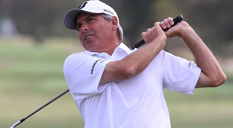 Fred Couples watches his approach shot on the ninth hole during the first round of the Mississippi Gulf Resort Classic.
