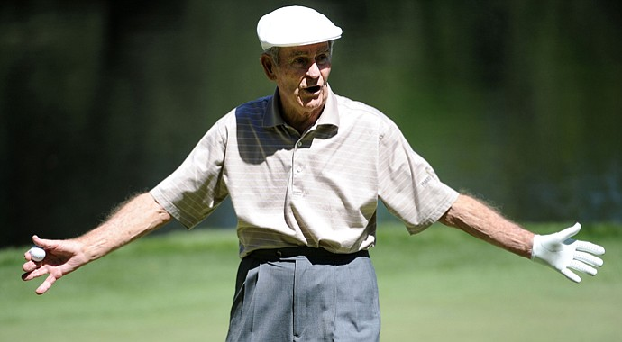Jack Fleck walks off a green during the Par 3 Contest prior to the 2011 Masters at Augusta National Golf Club.