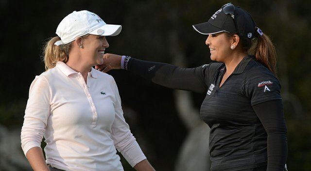 Cristie Kerr hugs Lizette Salas on the 18th hole after the third round of the Kia Classic.
