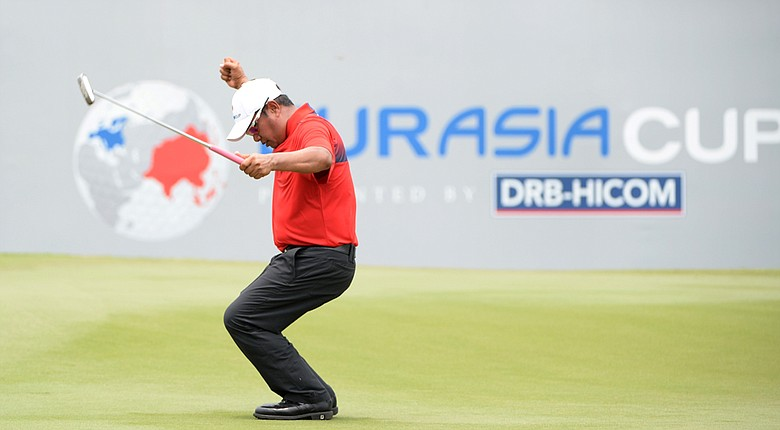 Pryad Marksaeng of Team Asia celebrates his putt on the 18th green during the single matches on Day 3 of the EurAsia Cup.