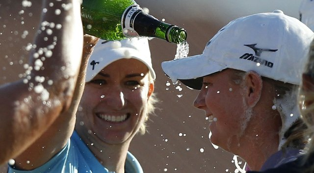 Karrie Webb, left, helps Stacy Lewis celebrate her 2011 Kraft Nabisco Championship win.