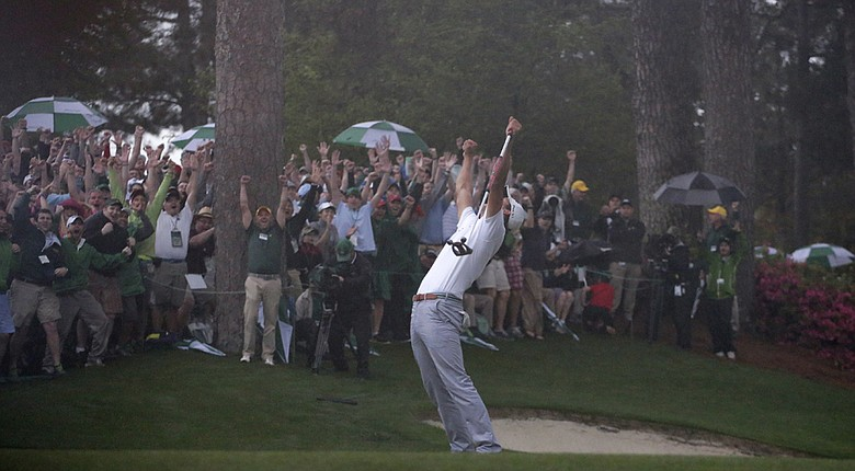 Adam Scott celebrates the winning putt at last year's Masters at Augusta National.