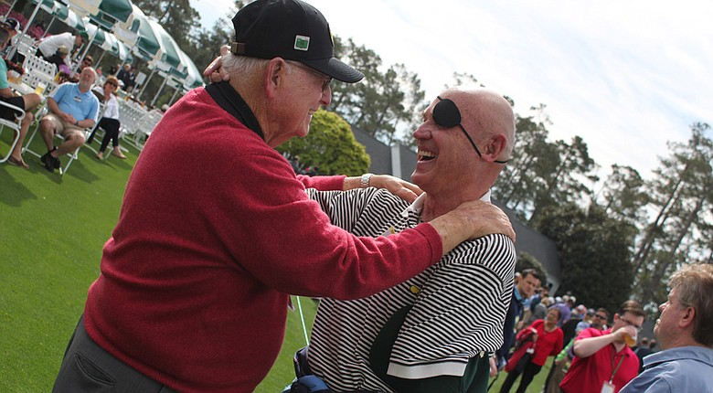 Billy Casper and Clebe McClary enjoy a long embrace after being reunited after 46 years.
