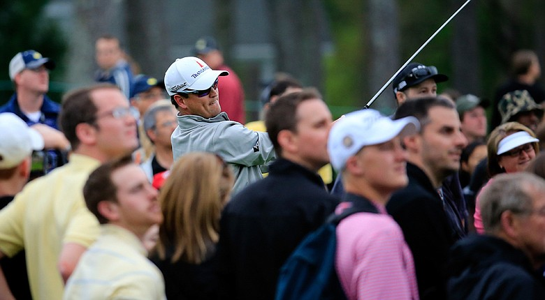 Zach Johnson, the 2007 Masters winner, follows his tee shot on the first hole while playing a practice round on Tuesday.