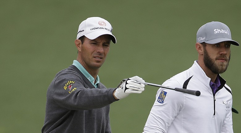 Mike Weir, left, and fellow Canadian Graham DeLaet during a Tuesday practice round for the 2014 Masters at Augusta National.