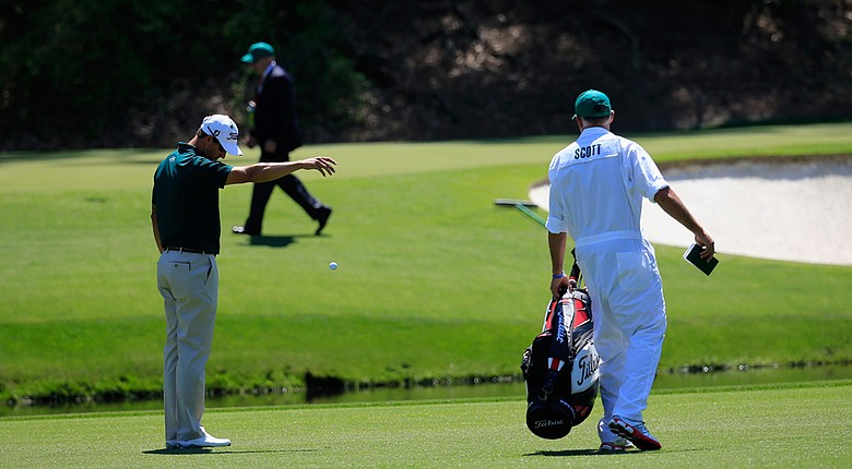 Adam Scott picked up a double bogey on the par-3 12th hole after finding the water in front of the green.