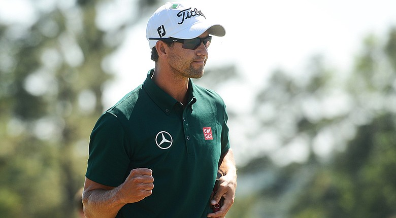 Adam Scott lets out a bit of emotion after making a 5-footer to save par on the 18th hole and secure a 3-under 69 on Thursday at the Masters.