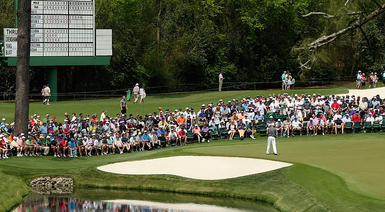 Thomas Bjorn makes a birdie putt on the 16th hole during the second round of the 2014 Masters.