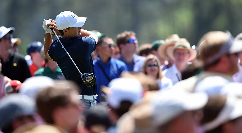 Jordan Spieth tees off on the 1st hole during the third round of the 78th Masters.