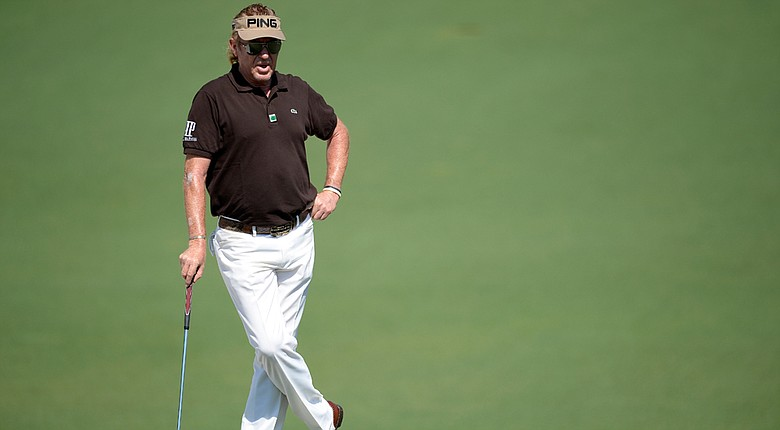 Miguel Angel Jimenez waits on the second green during the third round of the 2014 Masters.