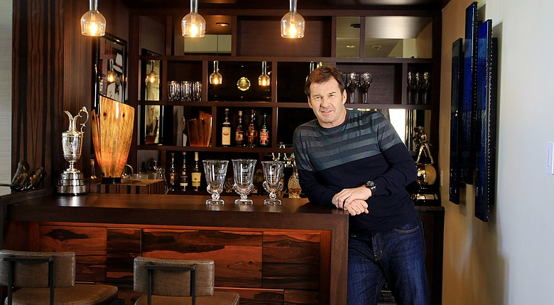 Nick Faldo at his home in Winter Park, Fla. with a few of his prized possessions, the Claret Jug and Masters vases.