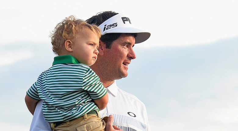 Bubba Watson holds son Caleb after winning the 2014 Masters at Augusta National.
