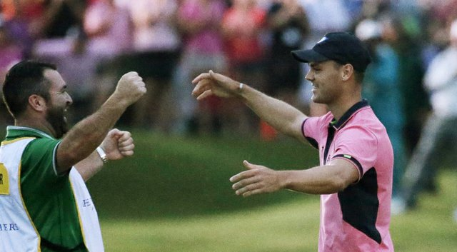 Martin Kaymer celebrates with caddie Craig Connolly after winning the PGA Tour's 2014 Players Championship at TPC Sawgrass in Ponte Vedra Beach, Fla.