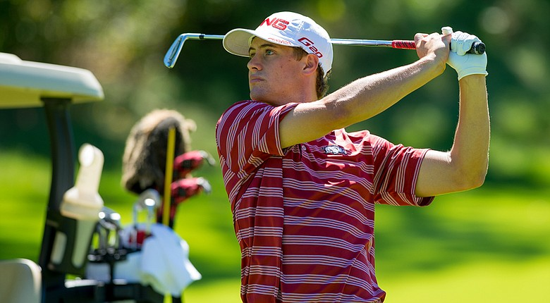 Arkansas' Taylor Moore is one shot off the individual lead at the Columbia (Mo.) Regional.