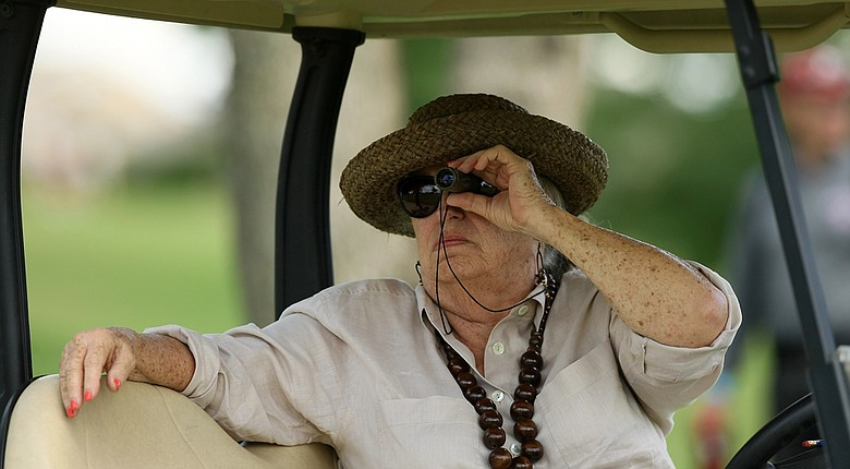 Coaching legend Dale McNamara watches Arizona State and head coach Melissa Luellen, her daughter, during Round 3 of the  2014 NCAA Division 1 Women's Golf Championships at Tulsa Country Club.