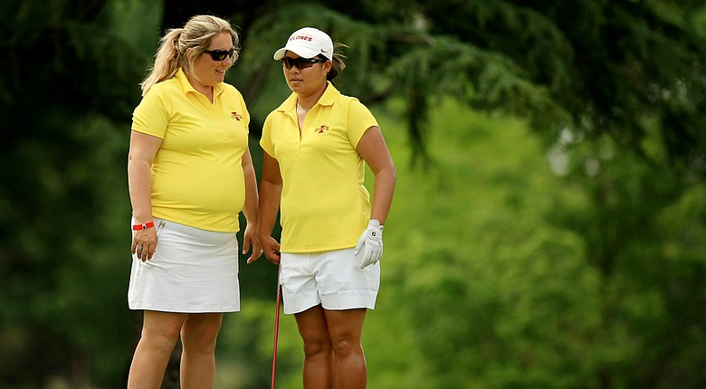 Iowa State head coach Christie Martens with Chonlada Chayanun during the final round of the 2014 NCAA Division 1 Women's Golf Championships at Tulsa Country Club.