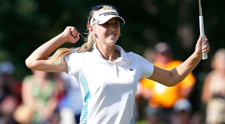 Jessica Korda celebrates her birdie putt on No. 18, giving her a one-shot victory at the Airbus LPGA Classic.