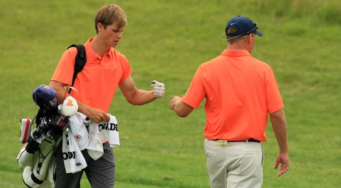 Thomas Detry of Illinois with head coach Mike Small at No. 18 on Monday of the NCAA Men's Division 1 Championship at Prairie Dunes Country Club in Hutchinson, Kan.
