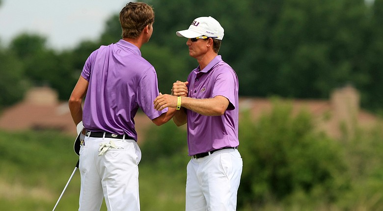 LSU assistant coach, Garrett Runion, hugs his player Smylie Kaufman as LSU defeated UCLA during Tuesday quarterfinals of match play of the NCAA Men's Division 1 Championship at Prairie Dunes Country Club in Hutchinson, Kan.