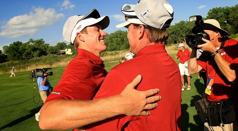 Alabama head coach Jay Seawell (right) congratulates freshman Robby Shelton after the Crimson Tide defeated Oklahoma State on Wednesday in the NCAA Men's Division I Championship at Prairie Dunes in Hutchinson, Kan.