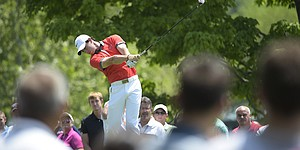 5 Things: Despite knee injury, McIlroy tames Muirfield