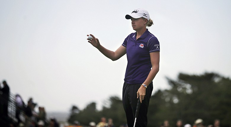Stacy Lewis shows her ball on the 18th hole during the second round of the ShopRite LPGA Classic. Lewis posted an 8-under 63 to take the lead.