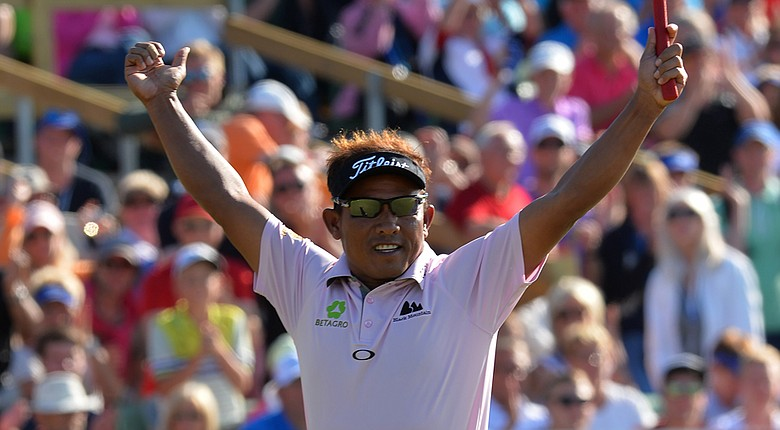 Thongchai Jaidee celebrates sinking the winning putt in the three-man playoff at the Nordea Masters.