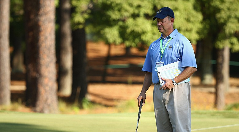 USGA executive director Mike Davis prepares to putt at Pinehurst on the eve of the 2014 U.S. Open.