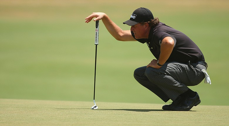 Phil Mickelson lines up a putt on the fifth green during the first round of the U.S. Open at Pinehurst No. 2.