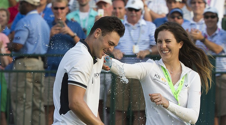 Martin Kaymer celebrates his U.S. Open win with German compatriot Sandra Gal on the 18th green at Pinehurst No. 2.