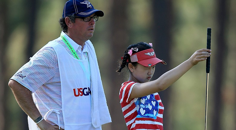 Caddie Bryan Bush (left) and Lucy Li grinded their way to a 7-over 78 in the first round of the U.S. Women's Open.