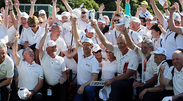 Mikko Ilonen poses with the course officals on the 18th fairway after winning the Irish Open by a shot over Edoardo Molinari.