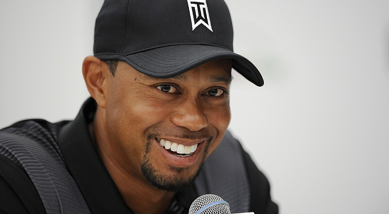 Tiger Woods during a Tuesday news conference for the PGA Tour's 2014 Quicken Loans National, where he will make his return to play this week after a back injury.