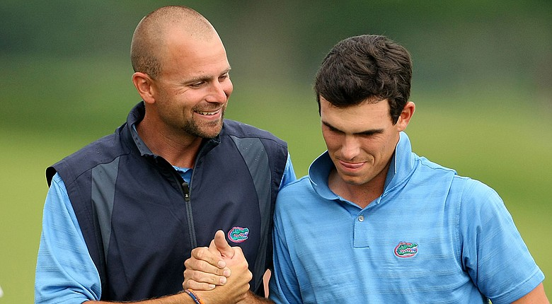Steve Bradley, left, hired Friday as the USF Bulls men's golf head coach, congratulates Billy Horschel on his SEC Championship when Bradley was an assistant at Florida.