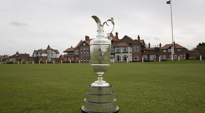 The Open Championship trophy and the clubhouse at Royal Liverpool in Hoylake, host of the 2014 British Open.