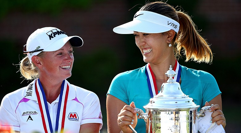 Stacy Lewis, defending champion at the Women's British, and Michelle Wie, who won the U.S. Women's Open in June, are close friends off the course, but push each other on it.