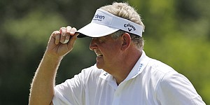 Montgomerie leads by one in Naples